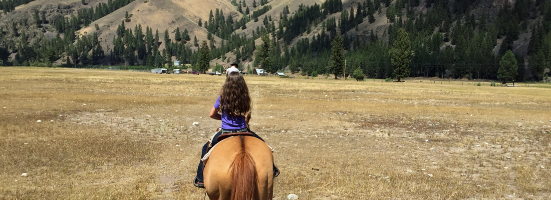 Girl-riding-horses-in-Montana
